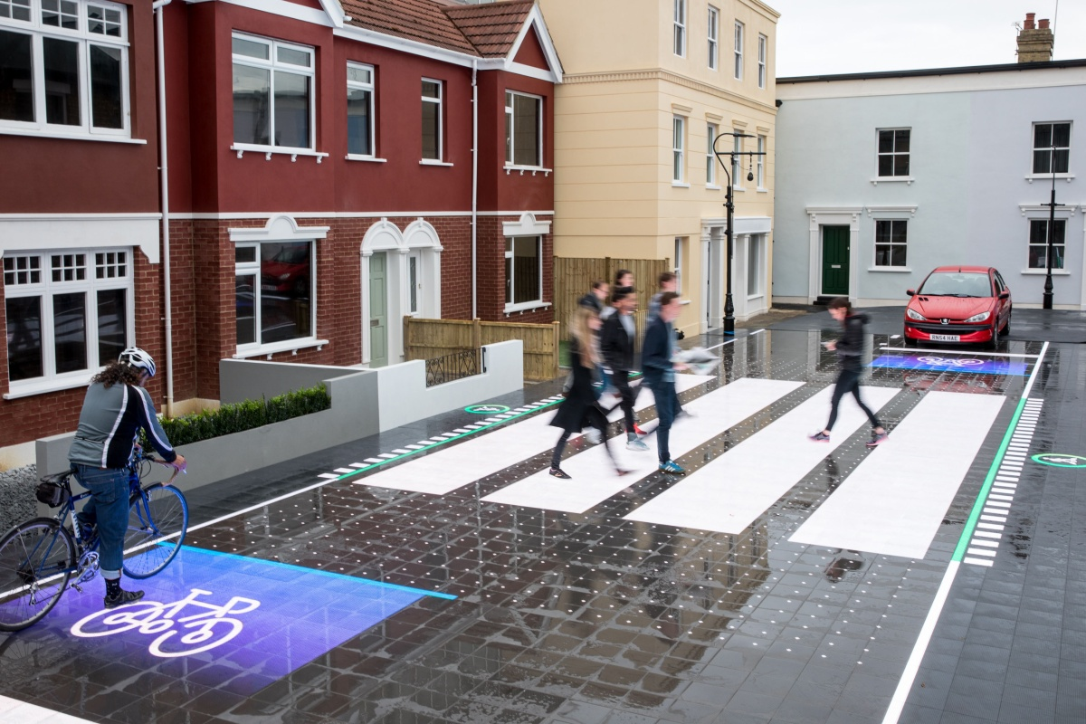 The smart crossing has a responsive surface which uses computer vision to see what's happening