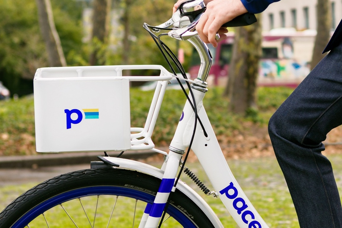 The parking platform supports Pace bikes and other dockless vehicles