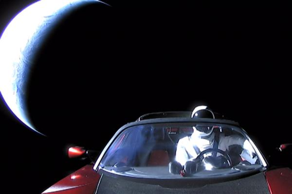 Cars in space, feet on the ground