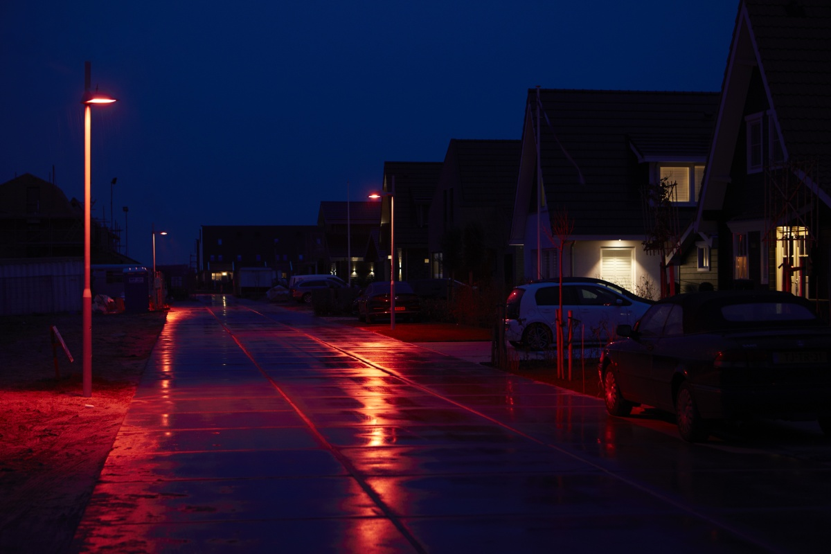 The special red lighting recipe illuminates the road for residents in the town