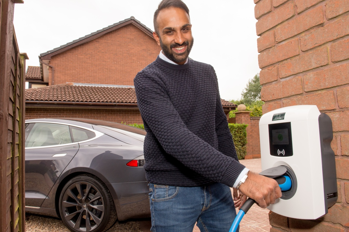 One of the final home chargers is installed for trial participant Sunny Vara