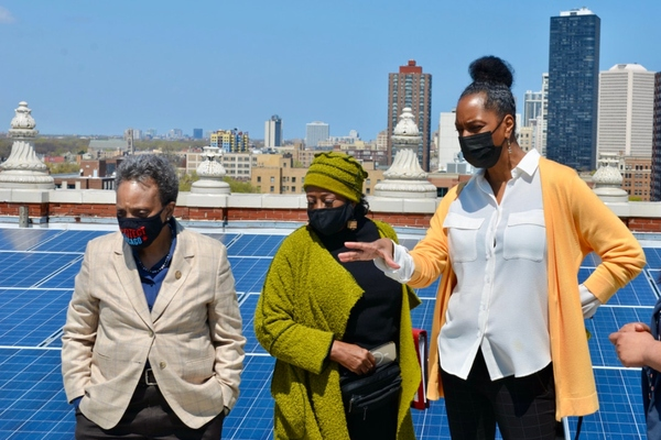Lesley Showers briefs mayor and Blacks In Green founder Naomi Davis on GreenRise's solar